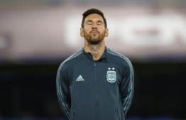 Argentina's Lionel Messi listens to the national anthem before the 2022 FIFA World Cup South American qualifier football match against Ecuador at La Bombonera stadium in Buenos Aires on October 8, 2020, amid the COVID-19 novel coronavirus pandemic. (Photo by AGUSTIN MARCARIAN / POOL / AFP)