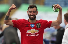 Manchester United manager Ole Gunnar Solskjaer confirmed Bruno Fernandes will captain the team in the Champions League matches in Paris. PHOTO/AFP