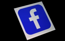 (FILES) In this file illustration photo taken on March 25, 2020 a Facebook App logo is displayed on a smartphone in Arlington, Virginia. - Facebook on October 19, 2020 unveiled software based on machine learning which the company said was the first to be able to translate from any of 100 languages without relying on English. The open-source artificial intelligence software was created to help the massive social network deliver content better in 160 languages to its more than two billion users around the world. (Photo by Olivier DOULIERY / AFP)
