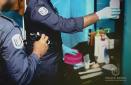 Officers of Maldives Police Service inspecting a residence for illegal narcotics. PHOTO: POLICE