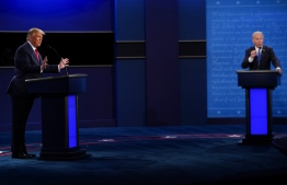 US President Donald Trump (L) and Democratic Presidential candidate and former US Vice President Joe Biden (R) participate in the final presidential debate at Belmont University in Nashville, Tennessee, on October 22, 2020. (Photo by Brendan Smialowski / AFP)