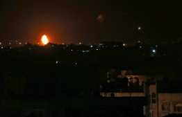 Flames are seen following an Israeli air strike in the town of Khan Yunis, in the southern Gaza Strip, early on October 23, 2020. - The Israeli army said two rockets were fired from Gaza towards Israel on the night of October 22, without causing any casualties or damage, and that one had been intercepted by air defences. (Photo by SAID KHATIB / AFP)