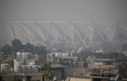 A general view shows the Jawaharlal Nehru Stadium under heavy smog conditions in New Delhi on October 23, 2020. (Photo by XAVIER GALIANA / AFP)
