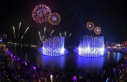 Dubai launches the Palm Fountain in a bid to break a Guinness World Record as the worlds' largest fountain, at Palm Jumeira on October 22, 2020. Spread over 14,000 square feet of seawater, the fountain's super shooter stands tall at 105 metres and comes alive with over 3,000 LED lights. Karim SAHIB / AFP
