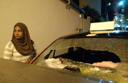 Aminath Waheed beside her vandalised vehicle. PHOTO: MIHAARU