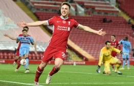 Liverpool's Portuguese striker Diogo Jota celebrates scoring his team's second goal during the English Premier League football match between Liverpool and West Ham United at Anfield in Liverpool, north west England on October 31, 2020. - Liverpool won the game 2-1. (Photo by PETER POWELL / POOL / AFP)