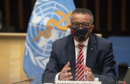 (FILES) In this file photo taken on October 05, 2020 a handout picture released by the World Health Organization shows World Health Organization (WHO) Director-General Tedros Adhanom Ghebreyesus (Photo by Christopher Black / World Health Organization / AFP)