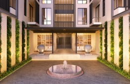 A photograph depicting the entrance to the residential building. PHOTO: AQUA VITA RESIDENCES