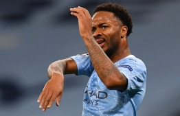 Manchester City's English midfielder Raheem Sterling reacts after having been caught offside during the UEFA Champions League football Group C match between Manchester City and Olympiakos at the Etihad Stadium in Manchester, north west England on November 3, 2020. (Photo by Paul ELLIS / AFP)