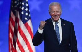 (FILES) In this file photo taken early on November 4, 2020 Democratic presidential nominee Joe Biden gestures after speaking during election night at the Chase Center in Wilmington, Delaware. - Joe Biden has won the US presidency over Donald Trump. (Photo by ANGELA  WEISS / AFP)