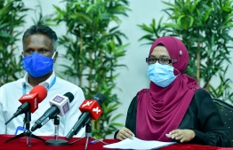 Planning Minister's Director General Fathimath Shana (R) and MTCC's CEO Adam Azim sign agreements awarding 10 projects worth MVR 1 billion to MTCC. PHOTO: NISHAN ALI / MIHAARU