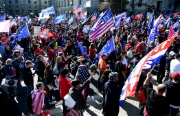 Supporters of US President Donald Trump rally in Washington, DC, on November 14, 2020. - Supporters are backing Trump's claim that the November 3 election was fraudulent. (Photo by Olivier DOULIERY / AFP)