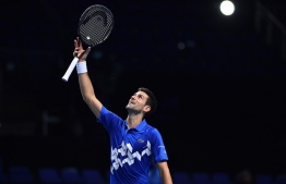 Serbia's Novak Djokovic celebrates after his straight sets win over Germany's Alexander Zverev in their men's singles round-robin match on day six of the ATP World Tour Finals tennis tournament at the O2 Arena in London on November 20, 2020. (Photo by Glyn KIRK / AFP)