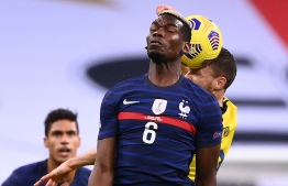 France's midfielder Paul Pogba (L) fights for the ball with Sweden's forward Marcus Berg during the UEFA Nations League A group 3 football match between France and Sweden at the Stade de France in Saint-Denis, north of Paris, on November 17, 2020. (Photo by FRANCK FIFE / AFP)