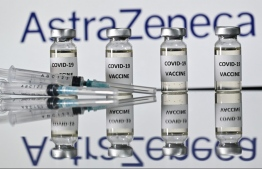 An illustration picture shows vials with Covid-19 Vaccine stickers attached and syringes with the logo of British pharmaceutical company AstraZeneca on November 17, 2020. (Photo by JUSTIN TALLIS / AFP)