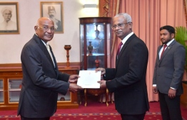 President Ibrahim Mohamed Solih presents the letter of appointment to Health Minister Ahmed Naseem