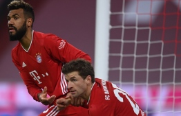 Bayern Munich's Cameroonian forward Eric Maxim Choupo-Moting and Bayern Munich's German forward Thomas Mueller react during the German first division Bundesliga football match Bayern Munich vs Werder Bremen in Munich, on November 21, 2020. (Photo by CHRISTOF STACHE / AFP) / DFL REGULATIONS PROHIBIT ANY USE OF PHOTOGRAPHS AS IMAGE SEQUENCES AND/OR QUASI-VIDEO