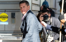 (FILES) In this file photo taken on December 18, 2018 former US National Security Advisor General Michael Flynn arrives for his sentencing hearing at US District Court in Washington, DC. - US President Donald Trump plans to pardon his former national security advisor Michael Flynn, who pleaded guilty in 2017 to lying to the FBI over his Russian contacts, US media reported on November 24, 2020. (Photo by SAUL LOEB / AFP)