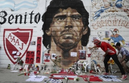 View of an improvised altar set up by Fans of Argentinos Juniors' football team where Argentinian football legend Diego Maradona used to play outside Argentinos Juniors' Diego Armando Maradona Stadium in La Paternal neighbourhood, Buenos Aires, on November 25, 2020, on the day of his death. (Photo by ALEJANDRO PAGNI / AFP)