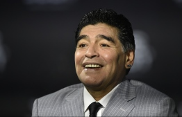 (FILES) In this file photo taken on January 09, 2017 Former Argentine football player Diego Maradona poses as he arrives for The Best FIFA Football Awards 2016 ceremony, in Zurich. - Argentinian football legend Diego Maradona passed away on November 25, 2020. (Photo by MICHAEL BUHOLZER / AFP)
