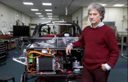"Hugo Spowers, chief engineer and founder of Riversimple, poses for a photograph with one of his company's hydrogen powered 'Rasa' cars in at his factory in Llandrindod Wells in central Wales on November 23, 2020. - Hydrogen-powered car manufacturer Riversimple is hoping to steal a march on competitors ahead of Britain's promised ""green revolution"", which would see petrol-powered cars banned within 10 years. Riversimple is only an ambitious upstart compared to the Asian automotive giants, but is currently the only British manufacturer in the sector with its flagship model, the Rasa. Founder Hugo Spowers is keen to take on the big boys with his self-designed model, whose name derives from the Latin 'tabula rasa', or clean slate. Advanced testing of the Rasa will begin over the next few months, with paying customers including Monmouthshire District Council in south Wales, which has given the go-ahead for a hydrogen refuelling station in the town of Abergavenny. (Photo by GEOFF CADDICK / AFP)"