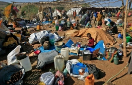 Ethiopian refugees who fled the Tigray conflict, start building temporary huts at Um Raquba camp in Sudan's eastern Gedaref province on November 28, 2020. More than 43,000 refugees have crossed into Sudan since fighting broke out in Tigray on November 4, UN High Commissioner for Refugees Filippo Grandi said as he visited Sudanese camps this week. ASHRAF SHAZLY / AFP