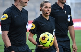 (FILES) In this file photo taken on August 9, 2020 French referee Stephanie Frappart holds the ball before the French friendly football match between Nimes Olympique and Olympique de Marseille (OM) at the Stade des Costieres in Nimes, southern France. - France's Stephanie Frappart will be the first woman to referee an UEFA Champions League football match, Juventus Turin v Dynamo Kiev on December 2, 2020. (Photo by Pascal GUYOT / AFP)