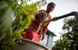Minati Bhuyan, 32 years old, gets ready to use her toilet in Sutarajpur village , Rayagada district, Odisha.  With over 250 people in the village, each house has at-least one toilet to cater to their sanitation needs. PHOTO/UNICEF