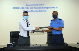 The agreement was signed by Interpol's Head of NCB and Commissioner of Police Mohamed Hameed and FIU's Head of Financial Intelligence Ibrahim Ahmed Nasir. PHOTO: MALDIVES POLICE SERVICE