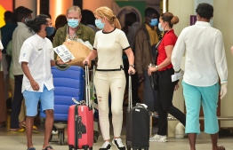 Tourists arriving at Velana International Airport. PHOTO: MIHAARU