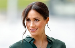 Meghan Markle is pictured above: The former actress became Duchess of Sussex and an American member of the British royal family through her marriage to Prince Harry, son of the heir to the throne, Prince Charles. PHOTO: AFP