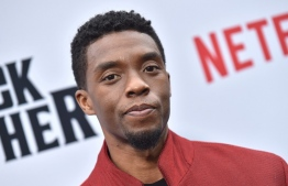 "(FILES) In this file photo taken on June 3, 2019 US actor Chadwick Boseman attends Netflix's ""The Black Godfather"" premiere at Paramount Studios Theatre in Los Angeles. - Four months after his death shocked the world, trailblazing US actor Chadwick Boseman makes his heartbreaking, hotly Oscar-tipped final film appearance in 1920s blues drama ""Ma Rainey's Black Bottom."" The ""Black Panther"" star portrays a feisty, irreverent horn player struggling to make himself heard in a Chicago music world riddled with racism and exploitation, in the August Wilson play adaptation out December 18, 2020 on Netflix. (Photo by LISA O'CONNOR / AFP)"