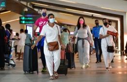 Tourists arriving to Maldives at Velana International Airport (VIA). PHOTO: MIHAARU