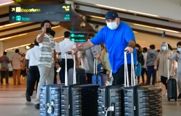 (FILE) Photo taken in December 21, 2020, that shows tourists in the Velana International Airport -- Maldives has seen over 600,000 tourist arrivals this year -- Photo: Nishan Al/ Mihaaru