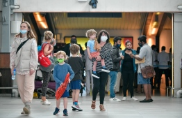 Tourists, wearing masks, pictured upon arrival at Velana International Airport. FILE PHOTO/MIHAARU