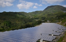 (FILES) This file photo taken on October 14, 2019 shows solar panels in Yufu, Oita prefecture. - Japan needs to boost renewable energy by reforming outdated policies on land use and the national grid if it is to meet a new goal of carbon neutrality by 2050, industry players and experts say. (Photo by CHARLY TRIBALLEAU / AFP) /