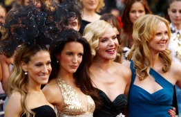 "(FILES) In this file photo taken on May 27, 2010 (FromL) US actress Sarah Jessica-Parker, US actress Kristin Davis, English actress Kim Cattrall and US actress Cynthia Nixon pose as they arrive at the UK premiere of ""Sex and the City 2"" in Leicester Square, central London, on May 27, 2010. - A revival of the hit show ""Sex and the City"" will come to HBO Max, the network announced Sunday, and will star all of its original leads except actress Kim Cattrall. The new series, titled ""And Just Like That..."", will consist of 10 episodes and feature Sarah Jessica Parker, Cynthia Nixon and Kristin Davis, HBO said in a statement. (Photo by MAX NASH / AFP)"