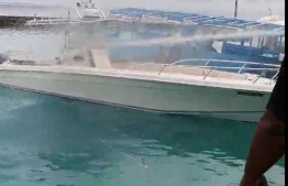 Amid attempts to put out a fire that broke out on a speedboat docked at V.Thinadhoo on January 12, 2021.