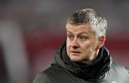 Manchester United's Norwegian manager Ole Gunnar Solskjaer reacts at the final whistle during the English League Cup semi final first leg football match between Manchester United and Manchester City at Ol d Trafford in Manchester, north west England, on January 6, 2021. (Photo by PETER POWELL / POOL / AFP)