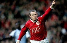 (FILES) In this file photo taken on December 9, 2006 Manchester United's Wayne Rooney scores against Manchester City during their English Premiership football match at Old Trafford, Manchester, England. - Wayne Rooney has ended his illustrious playing career to take up a job as full-time Derby manager, the Championship club announced on Friday, January 15. (Photo by Paul ELLIS / AFP)