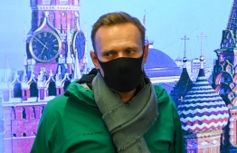 Russian opposition leader Alexei Navalny is seen at Moscow's Sheremetyevo airport upon the arrival from Berlin on January 17, 2021. - Russian police detained Kremlin critic Alexei Navalny at a Moscow airport shortly after he landed on a flight from Berlin, an AFP journalist at the scene said. (Photo by Kirill KUDRYAVTSEV / AFP)