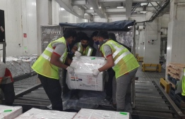 Airport staff unloading the COVISHIELD vaccine shipment that arrived from India on January 20. PHOTO: MIHAARU