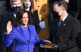 Kamala Harris, flanked by her husband Doug Emhoff, is sworn in as the 49th US Vice President by Supreme Court Justice Sonia Sotomayor on January 20, 2021, at the US Capitol in Washington, DC. (Photo by Brendan SMIALOWSKI / AFP)