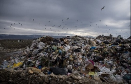 This picture taken on January 14, 2021, shows an illegal dumpsite near the city of Struga. - The Western Balkans are home to some of Europe's wildest rivers and most pristine tracts of nature. But failing waste management systems across the region are threatening the environment and public health. Heavy rains in January highlighted the problem after floods swept garbage from roadsides and other illegal dumps into rivers. (Photo by Robert ATANASOVSKI / AFP)