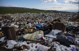 This picture on January 15, 2021, shows an illegal dumpsite near the village of Aracinovo near Skopje. - The Western Balkans are home to some of Europe's wildest rivers and most pristine tracts of nature. But failing waste management systems across the region are threatening the environment and public health. Heavy rains in January highlighted the problem after floods swept garbage from roadsides and other illegal dumps into rivers. (Photo by Robert ATANASOVSKI / AFP)