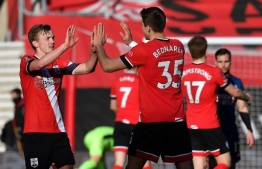 Southampton's English midfielder James Ward-Prowse (L) and Southampton's Polish defender Jan Bednarek react at the final whistle during the English FA Cup fourth round football match between Southampton and Arsenal at St Mary's Stadium in Southampton, Hampshire,on January 23, 2021. (Photo by Ben STANSALL / AFP) / RESTRICTED TO EDITORIAL USE. No use with unauthorized audio, video, data, fixture lists, club/league logos or 'live' services. Online in-match use limited to 120 images. An additional 40 images may be used in extra time. No video emulation. Social media in-match use limited to 120 images. An additional 40 images may be used in extra time. No use in betting publications, games or single club/league/player publications. /