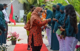 Minister of Gender, Family and Social Services Aishath Mohamed Didi greets those working on the project, during the opening ceremony of the Amaan Hiyaa residences built to house children placed in state-care. PHOTO: GENDER MINISTRY