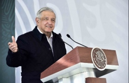 Handout picture released by Mexico's Presidency press office showing Mexico's President Andres Manuel Lopez Obrador delivering a speach during the inauguration of the new facilities for the National Guard in San Luis Potosi, Mexico on January 24, 2021. (Photo by Handout / Mexican Presidency / AFP) /
