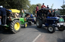 Farmers take part in a tractor rally as they continue to protest against the central government's recent agricultural reforms in New Delhi on January 26, 2021. Sajjad HUSSAIN / AFP