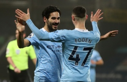 Manchester City's midfielder Phil Foden celebrates with German midfielder İlkay Gündoğan and teammates during the English Premier League football match between West Bromwich Albion and Manchester City at The Hawthorns stadium in West Bromwich, central England, on January 26, 2021.